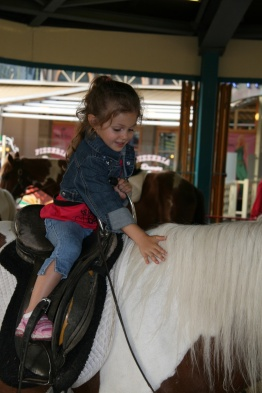 Riding a pony in The Prater in Vienna